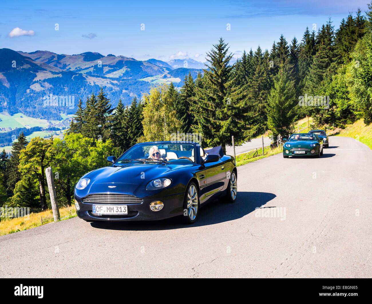 Aston Martin DB7 Vantage Volange cars on a mountain road near Kitzbühel, Tyrol, Austria - Stock Image
