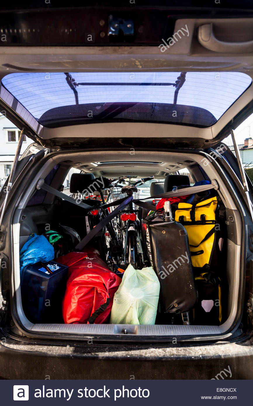 Mountaineering equipment loaded in car trunk - Stock Image