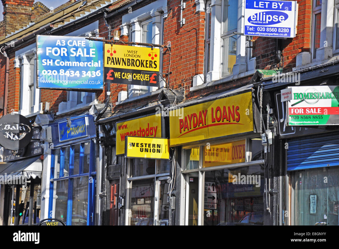 Payday loans and various other shops and lettings signs on South Ealing Road, London W5, England, UK. - Stock Image