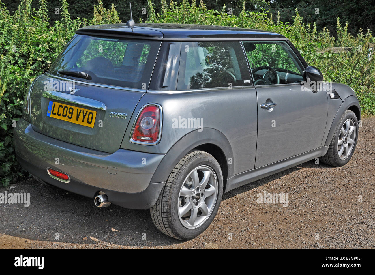 2009 GB registered, iconic, classic design, Mini Cooper (manufactured by BMW). The car is parked and unoccupied - Stock Image