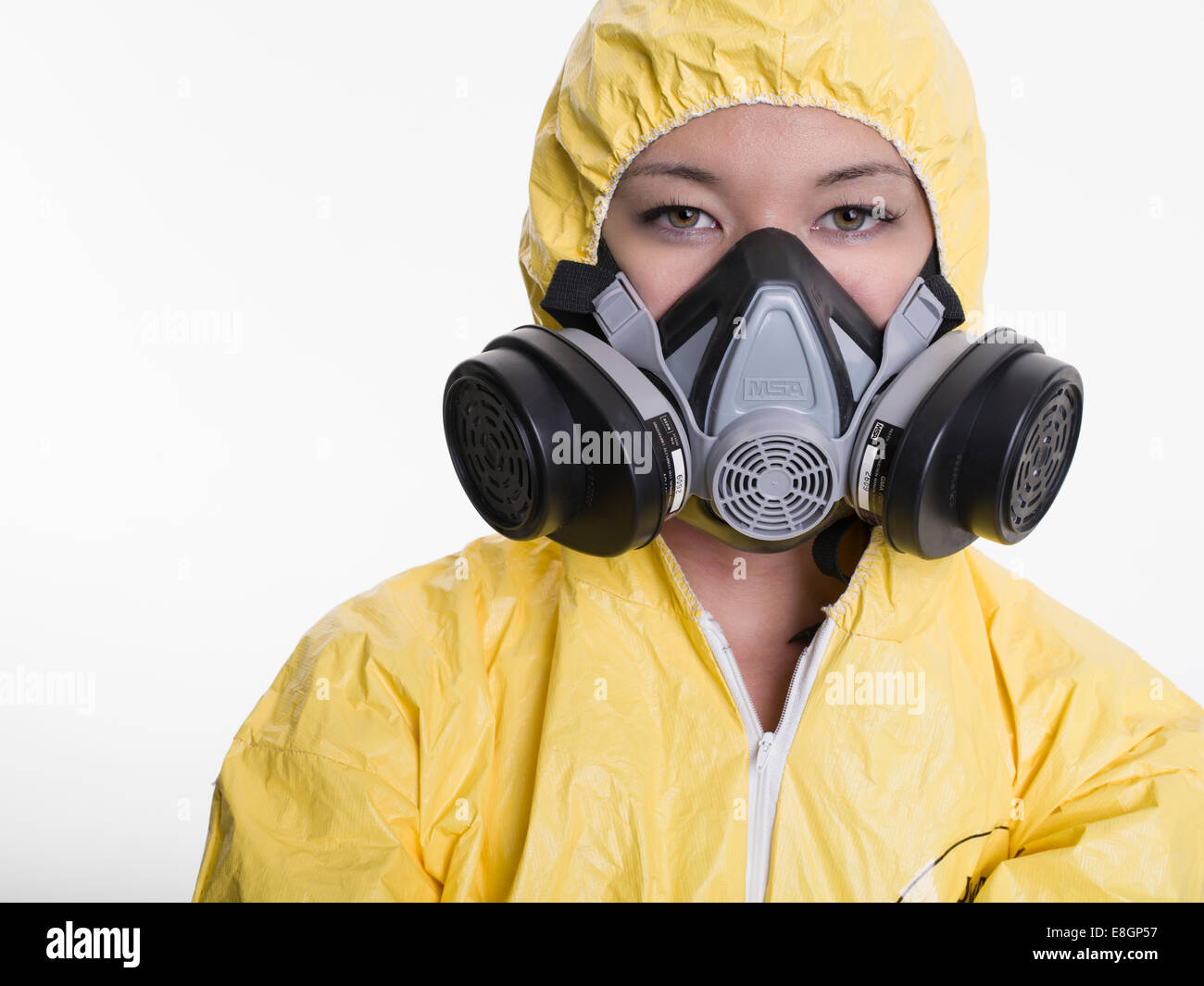 Woman with hazmat hazardous materials suit and gas mask - Stock Image