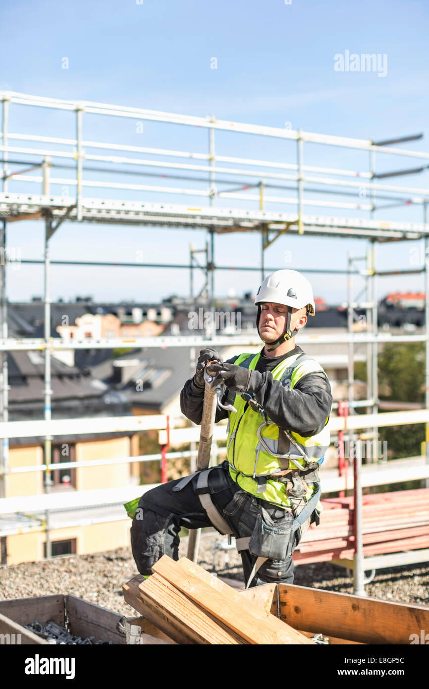 Construction worker working at site - Stock Image