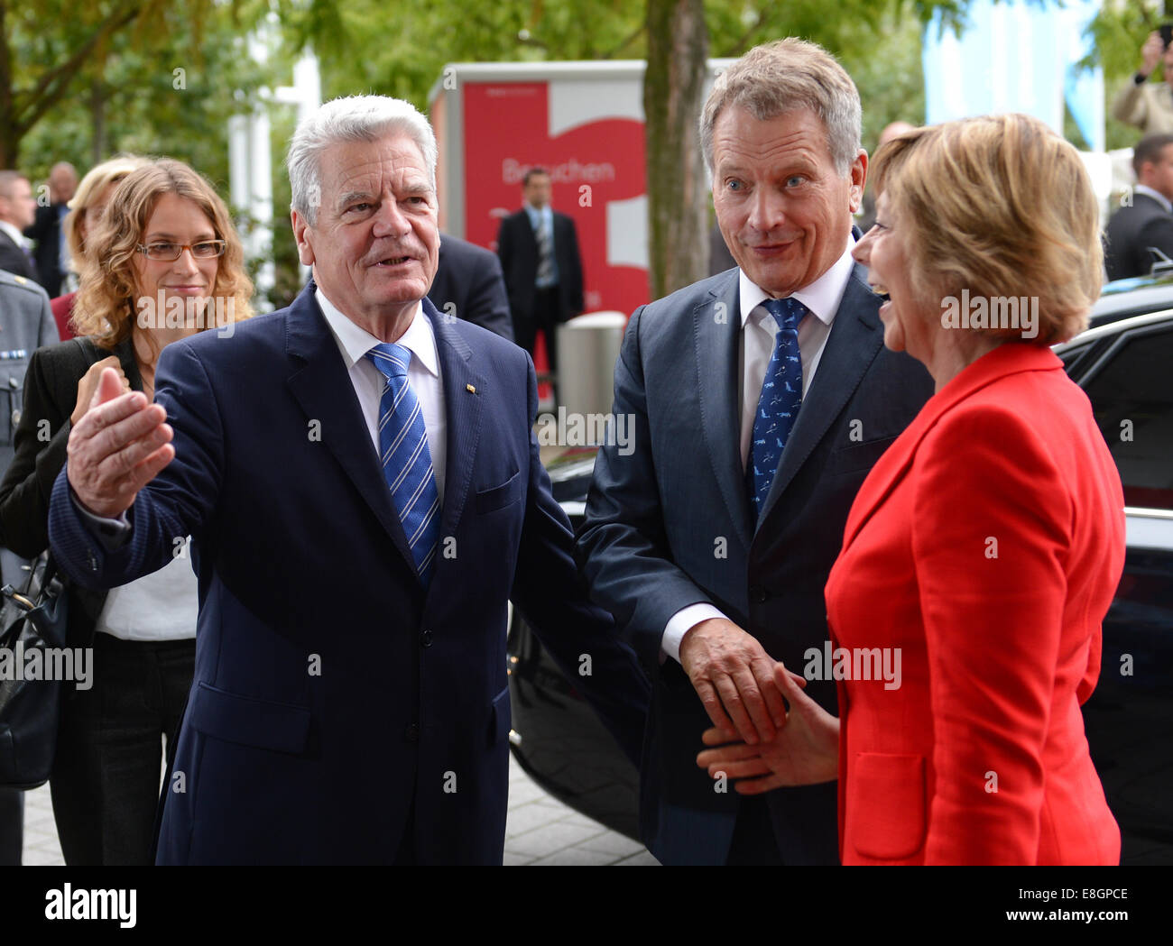 German President Joachim Gauck (L) and his partner Daniela Schadt greet the Finnish President Sauli Niinisto and - Stock Image