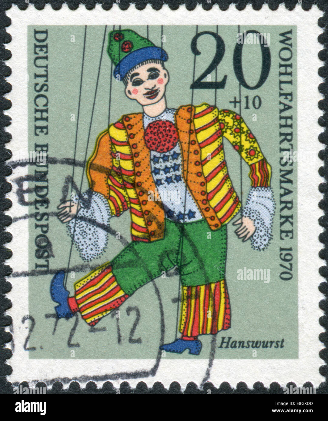 """Postage stamp printed in Germany, shows a puppet """"Hanswurst"""" from the collection of puppet theater in Munich Stock Photo"""