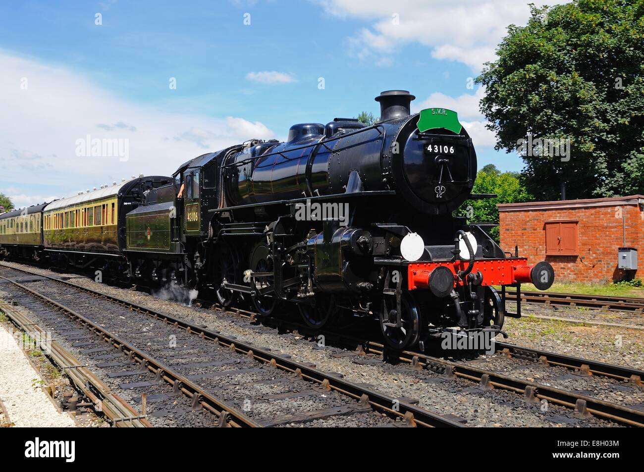Steam Locomotive Ivatt Class 4 2-6-0 number 43106 in British Rail Black approaching the railway station, Arley, Stock Photo