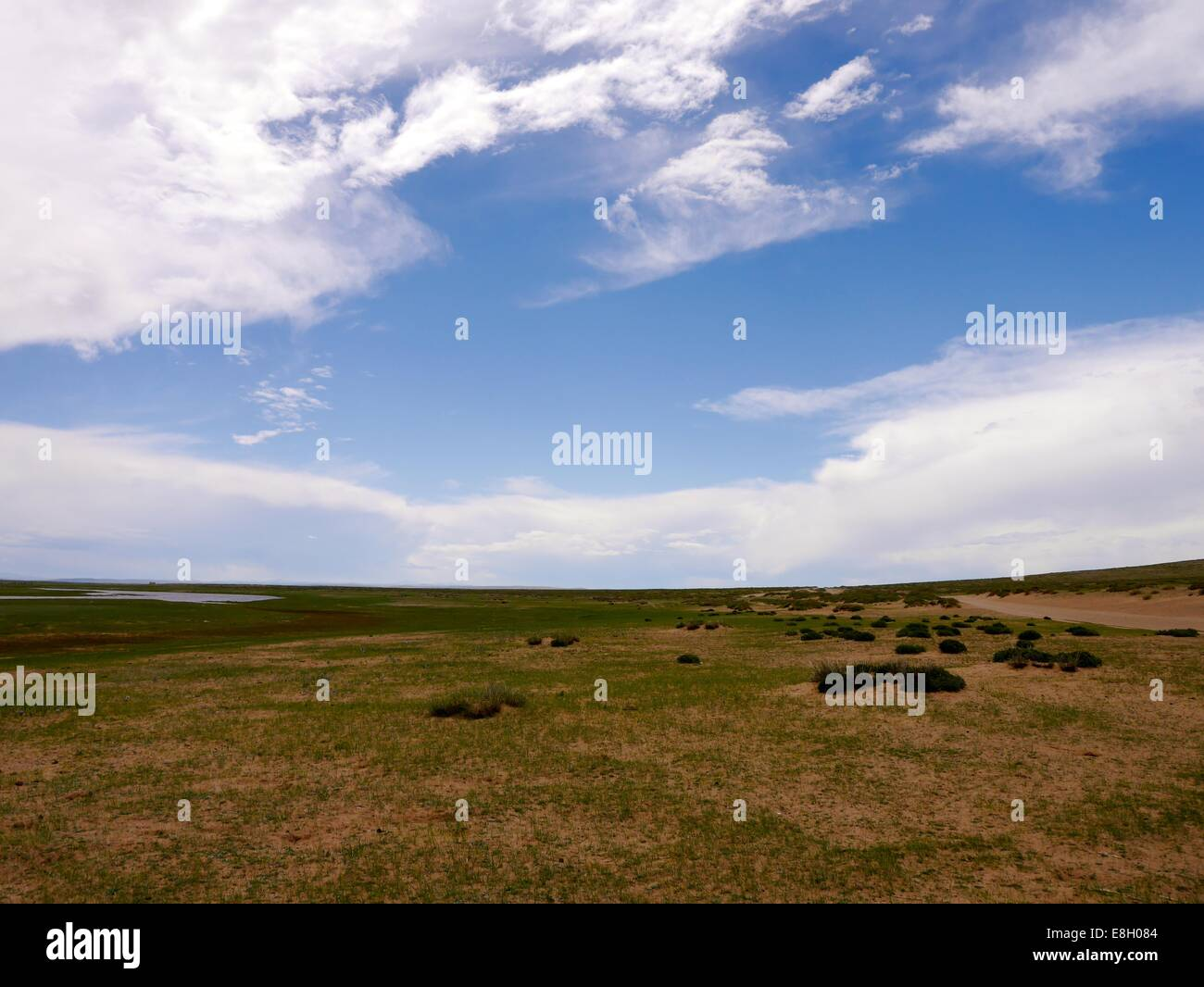 A blue patch of sky over Ogii Nuur district, Mongolia. - Stock Image
