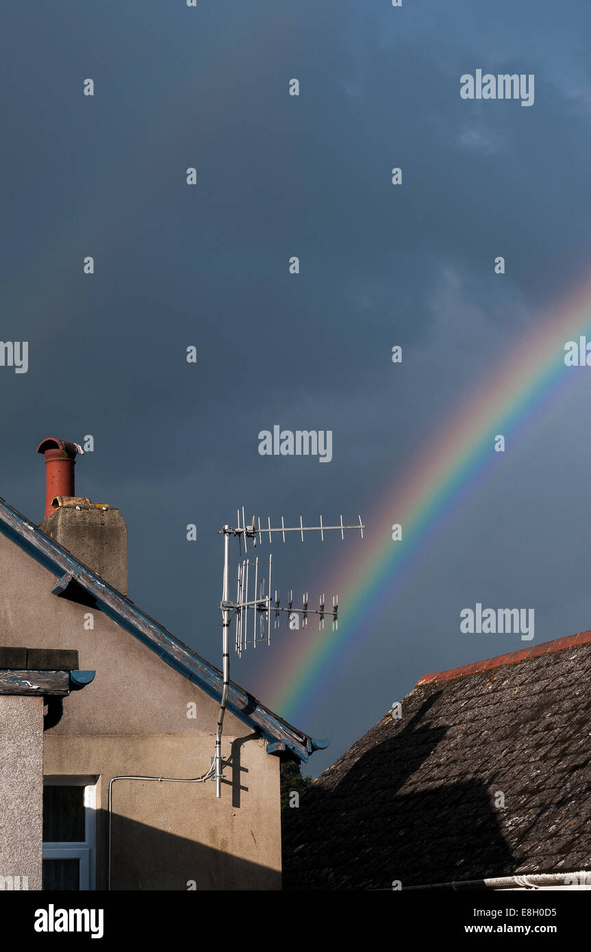 rainbow over rooftops,antennae, antenna, tv, broadcasting, aerial, clear, outdated, technical, program, frequency, - Stock Image