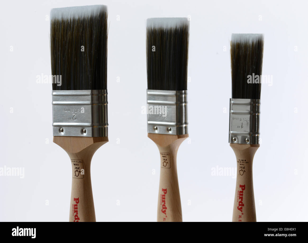 Three different size paint brushes - Stock Image