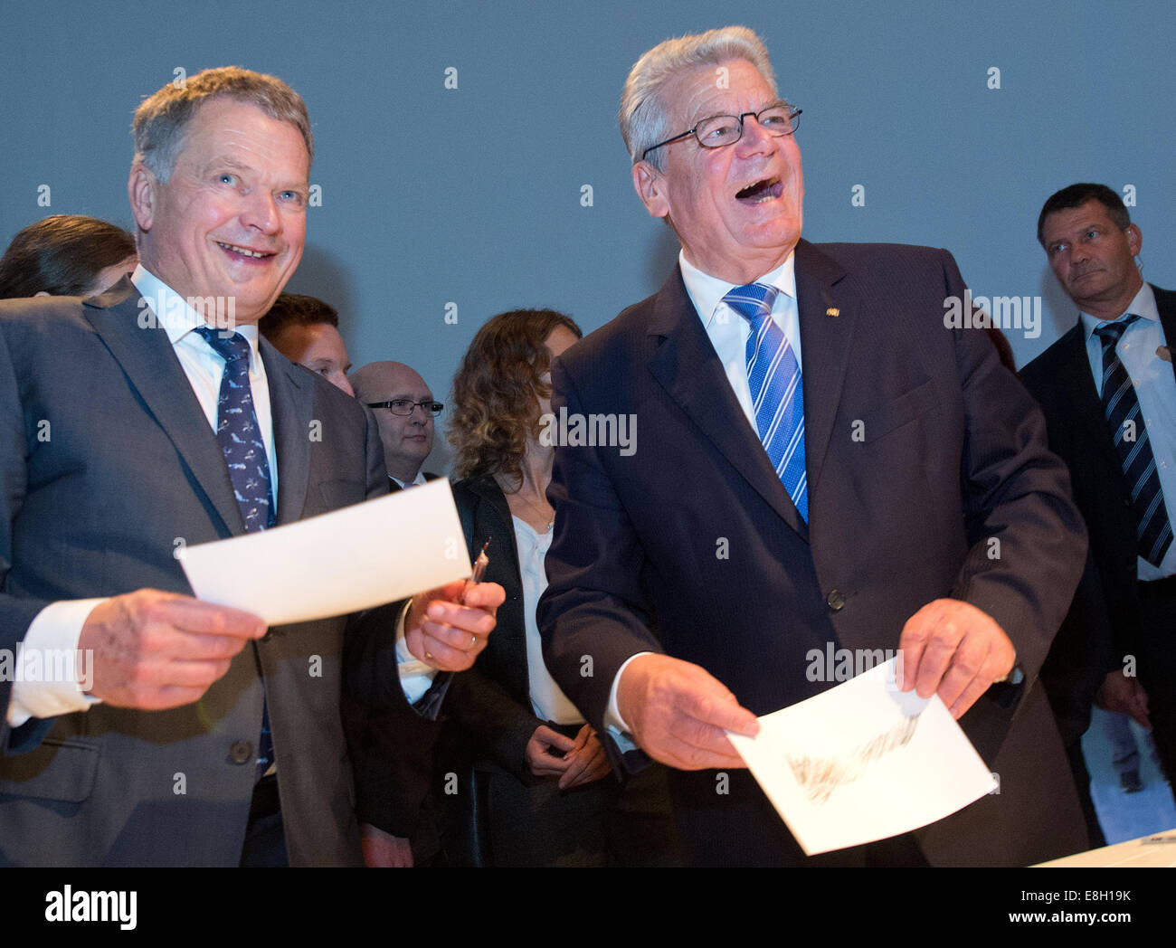 Finnish President Sauli Niinisto (L) and German President Joachim Gauck touring the Finnish Pavillion at the book - Stock Image