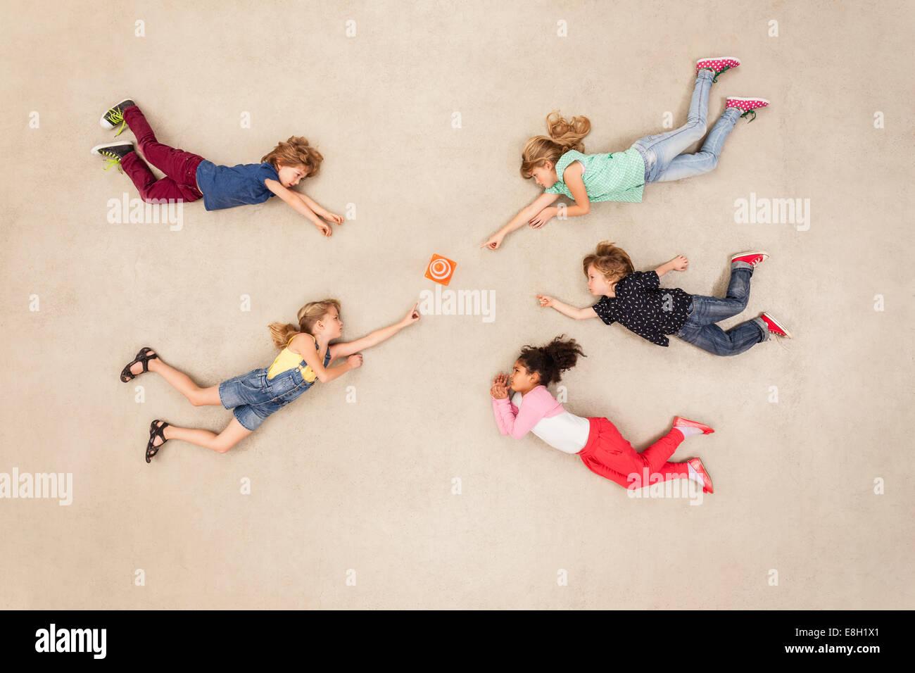 Children discovering new mini gadget - Stock Image