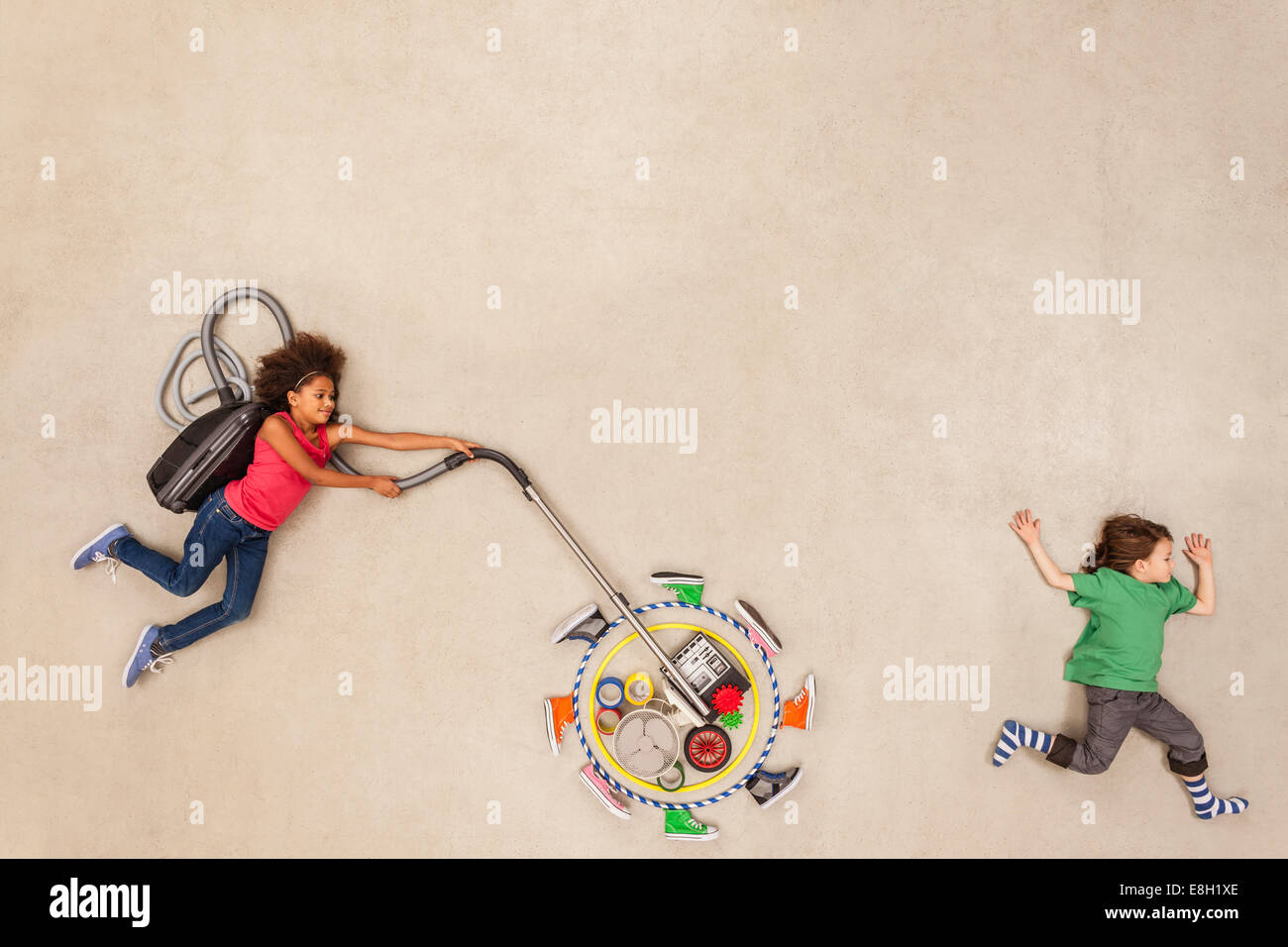Children developing new gadgets - Stock Image