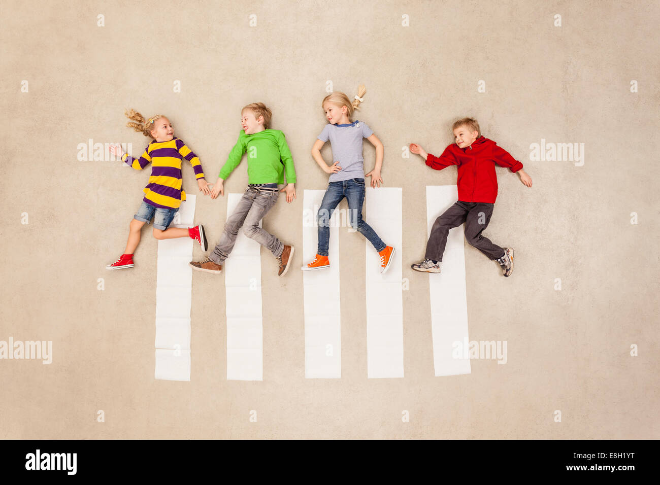Children walking at zebra crossing Stock Photo