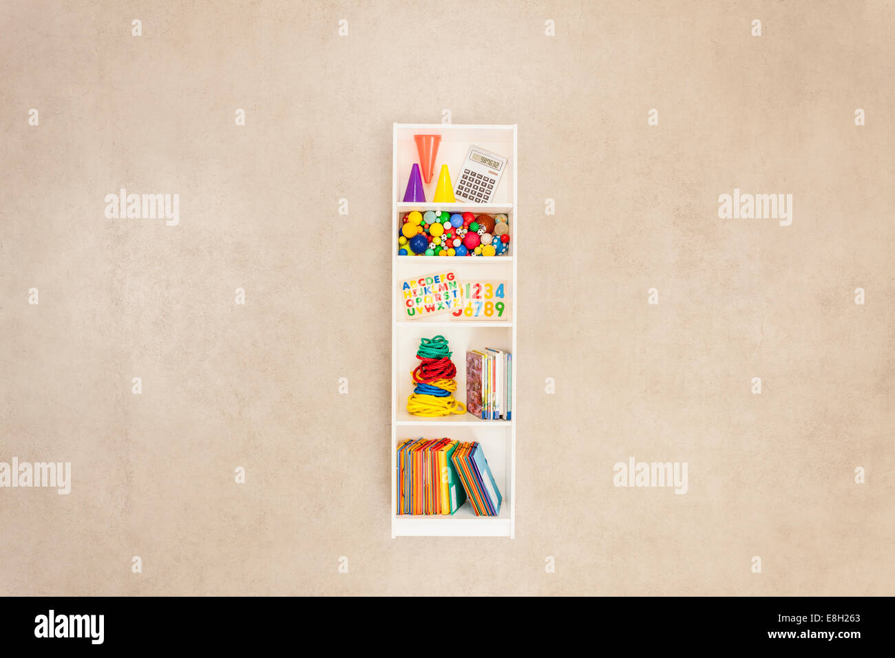 Shelf containing school items - Stock Image