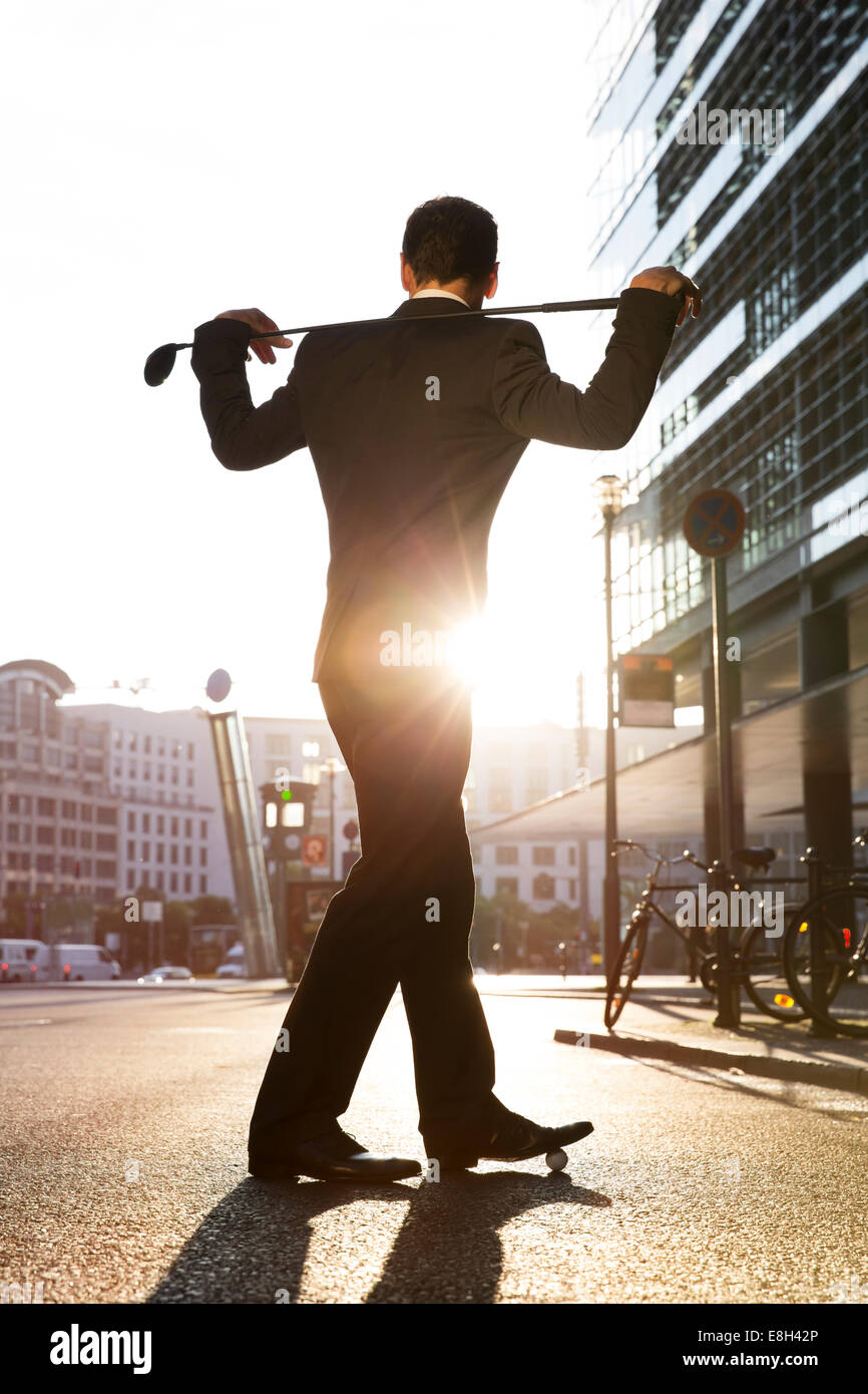 Germany, Berlin, Businessman cross golfing - Stock Image