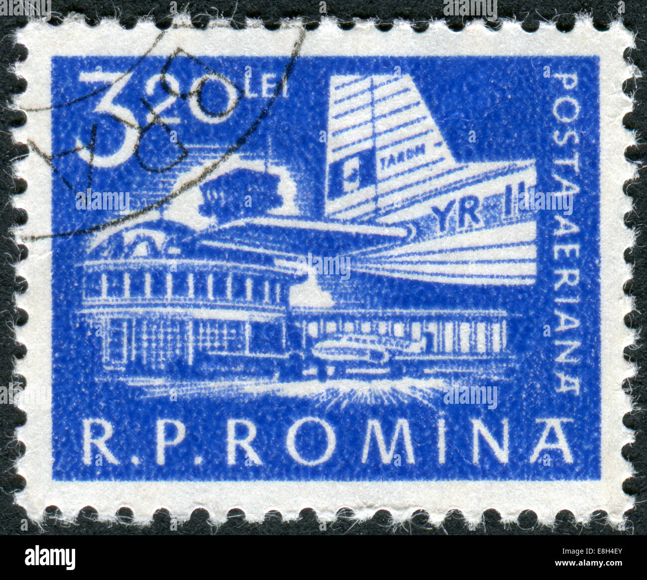 Postage stamp printed in Romania shows Airplane at Bucharest Airport - Stock Image