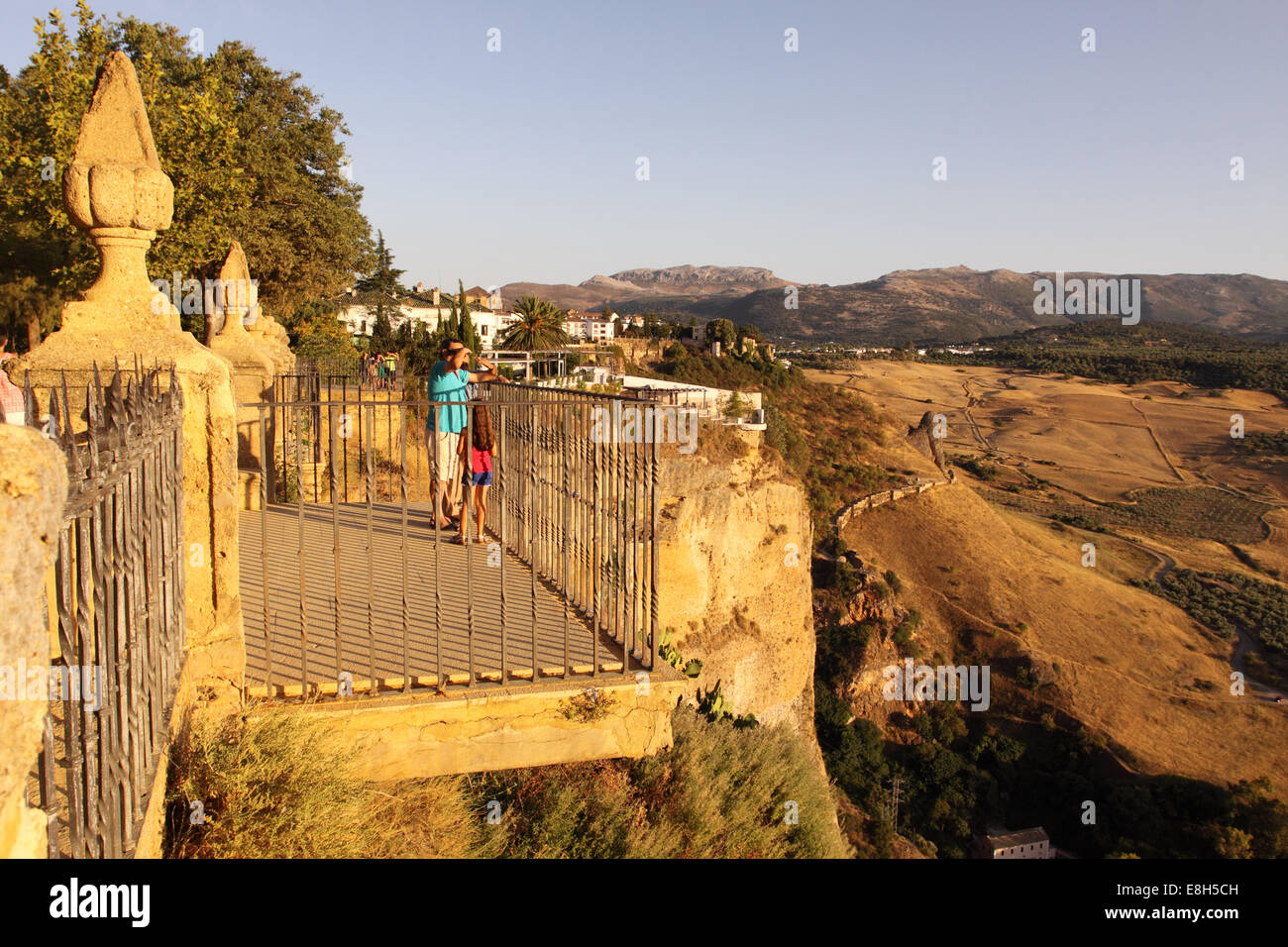 Ronda Spain the town sits on top of tall cliffs giving spectacular views across the  nearby Sierra de Grazalema mountains Stock Photo