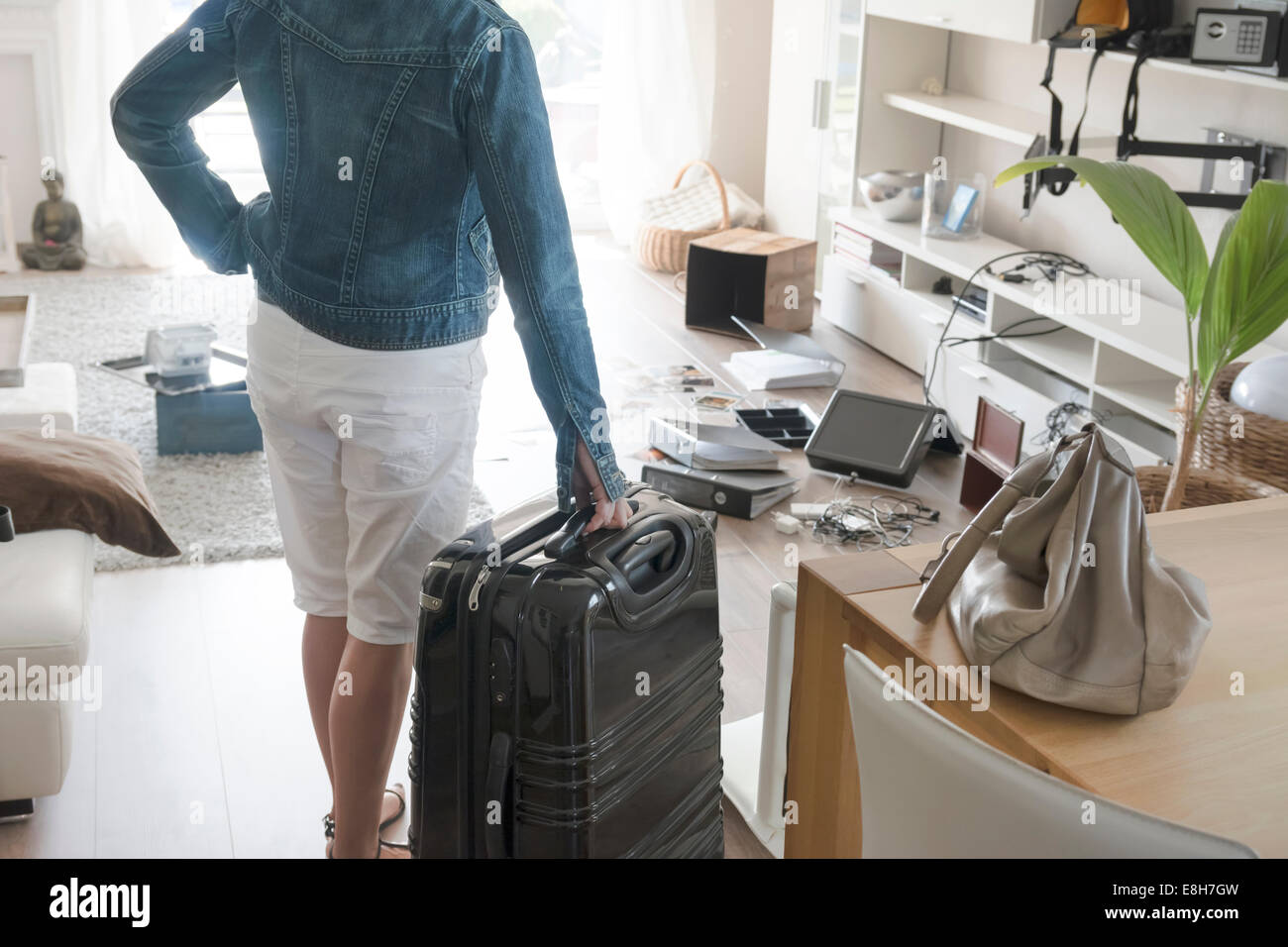 Female holidaymaker watching chaos after burglary after comeback in her one-family house - Stock Image