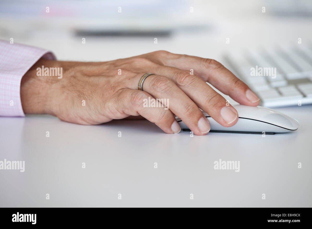 Man's hand on a computer mouse - Stock Image