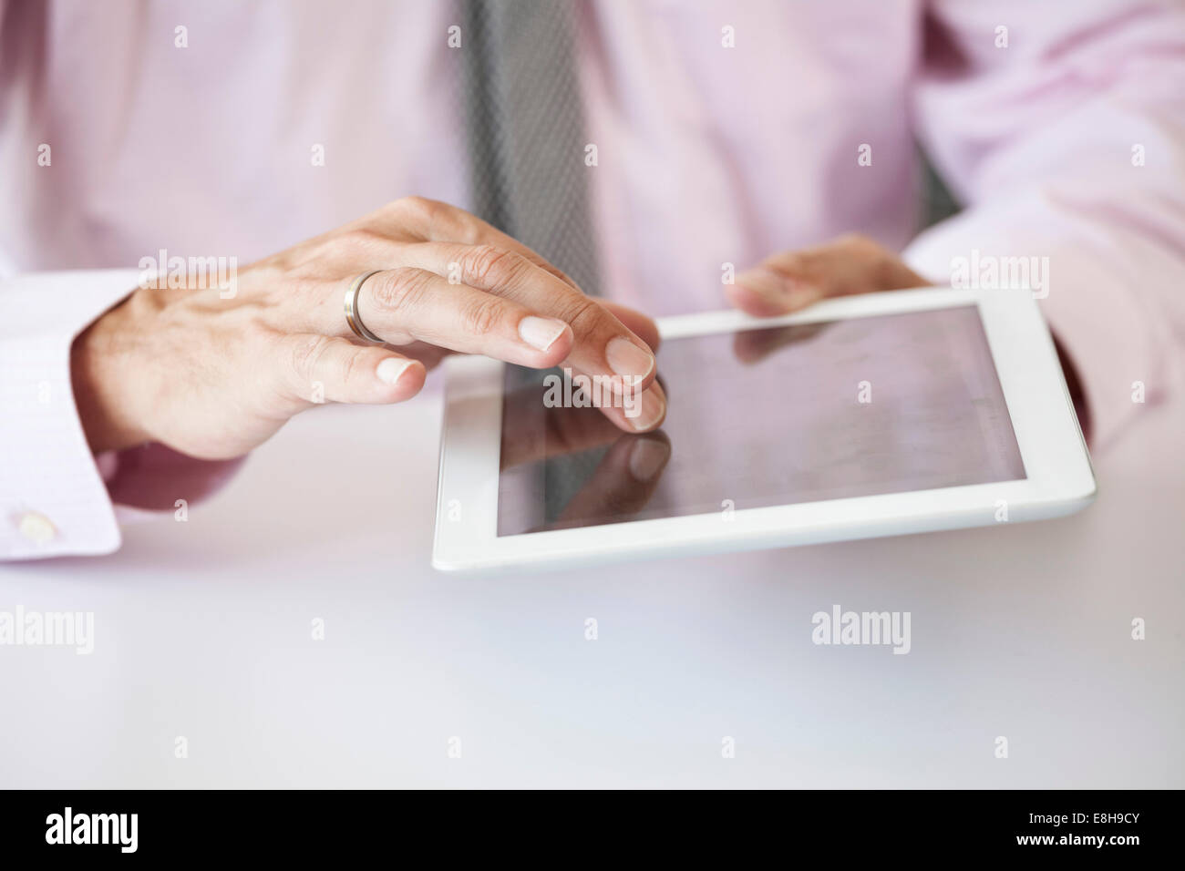 Man's hand on a tablet computer - Stock Image