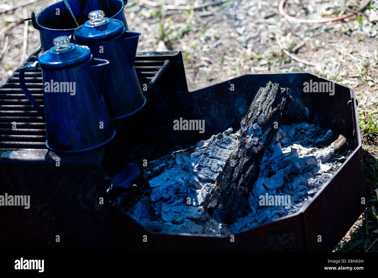 Pots Boiling Water On Camping Fire Pit With Wood