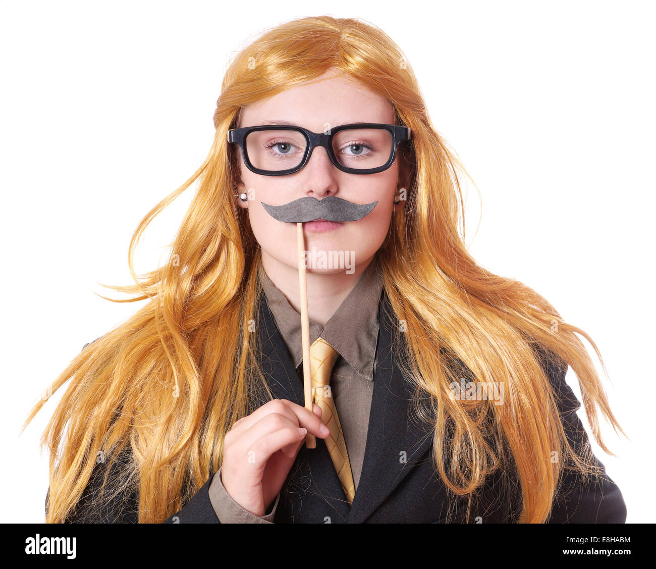 young woman with fake moustache dressed up as a man - Stock Image