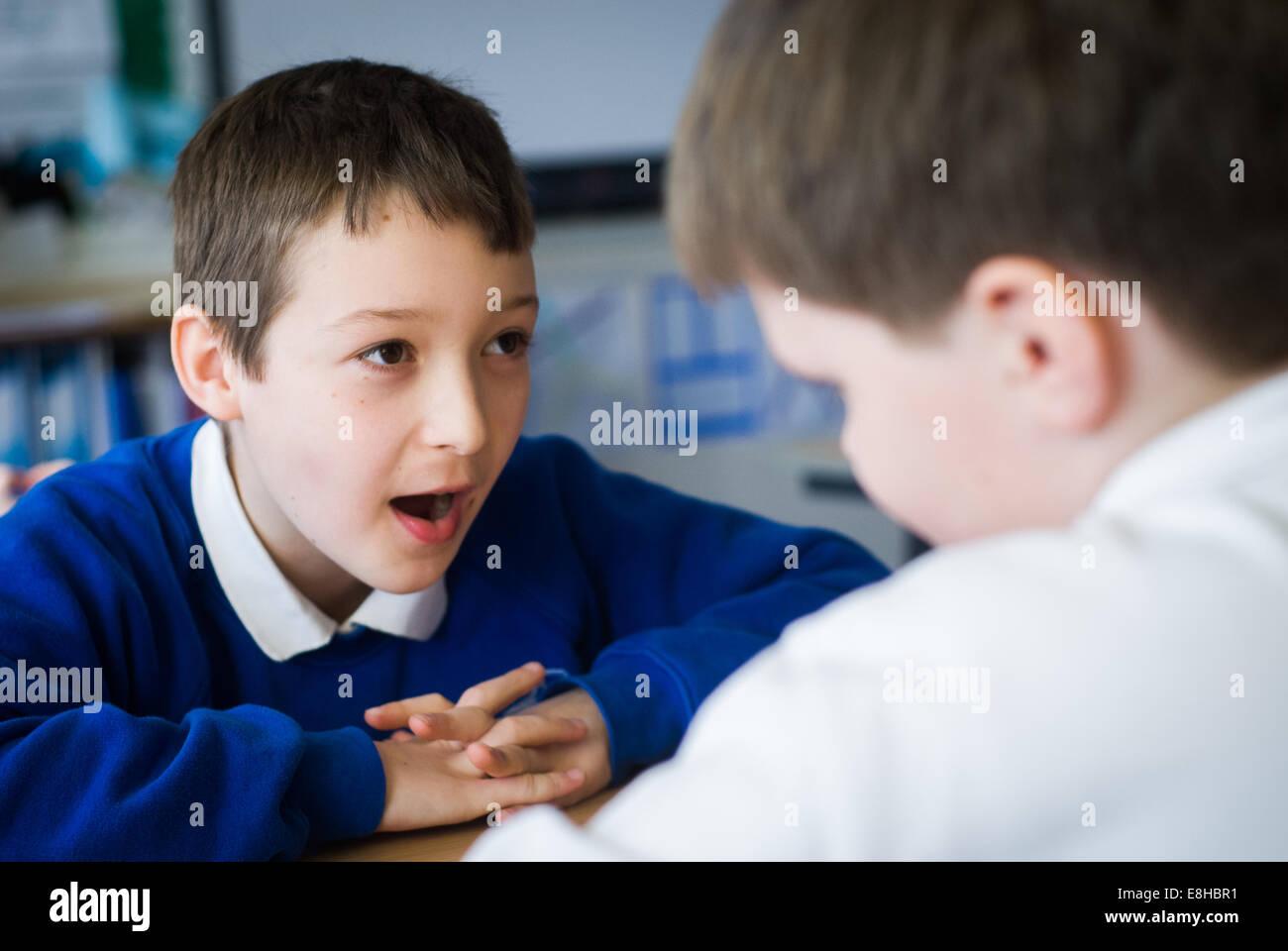 2 boys in Primary school classroom in Oxfordshire,UK Stock Photo