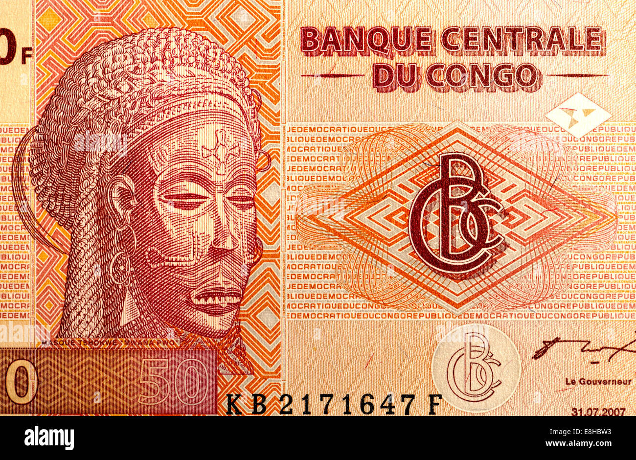 Detail from Congo 50F banknote showing Tshokwe mask 'Mwana Pwo' - Stock Image