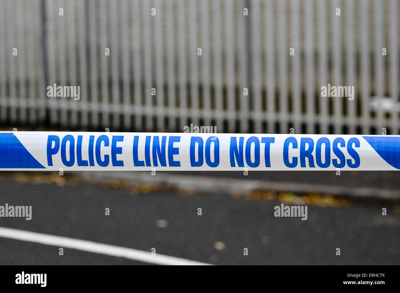 Police tape stretched across a road at a crime scene cordon point.   Credit:  Stephen Barnes/Alamy Live News - Stock Image