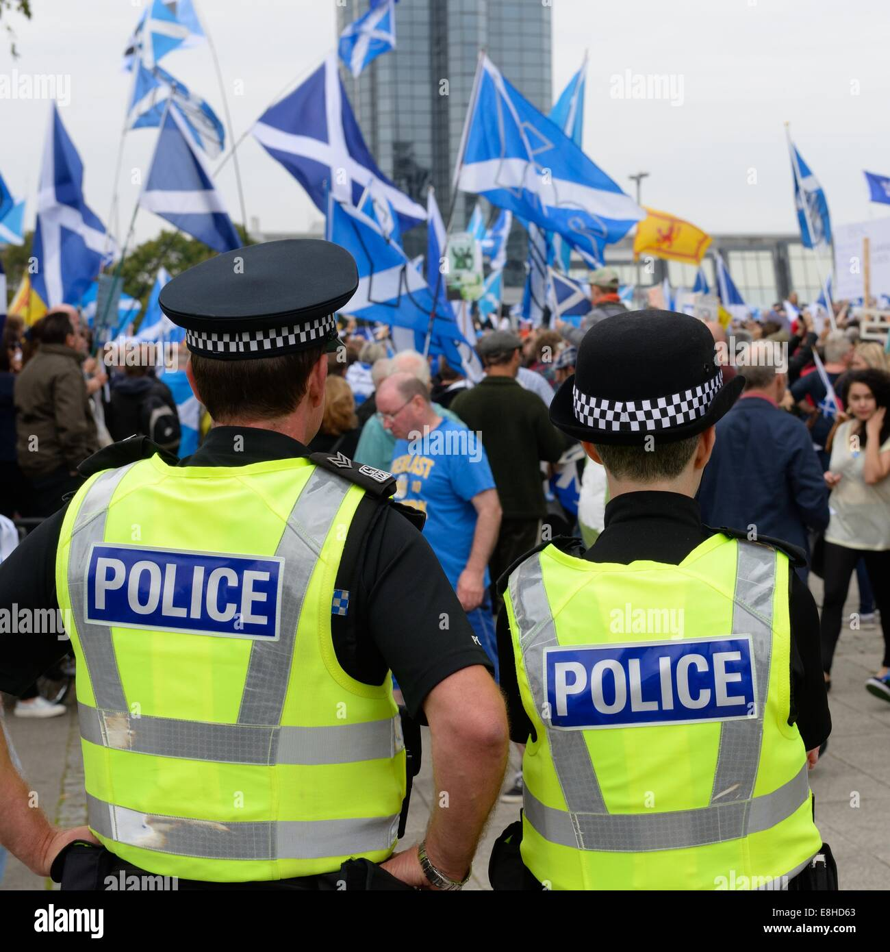 Male and female police officers observe a political rally in Glasgow, Scotland, UK, Europe - Stock Image