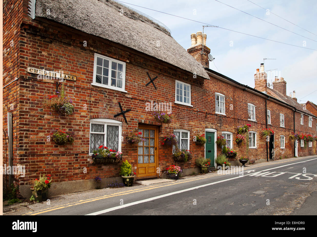 Grade II listed Old thatched cottages on Church Lane in Christchurch Dorset - Stock Image