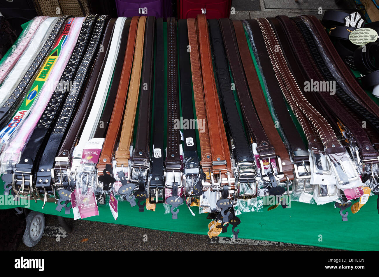 Leather belts for sale in East Street Market, London, UK - Stock Image