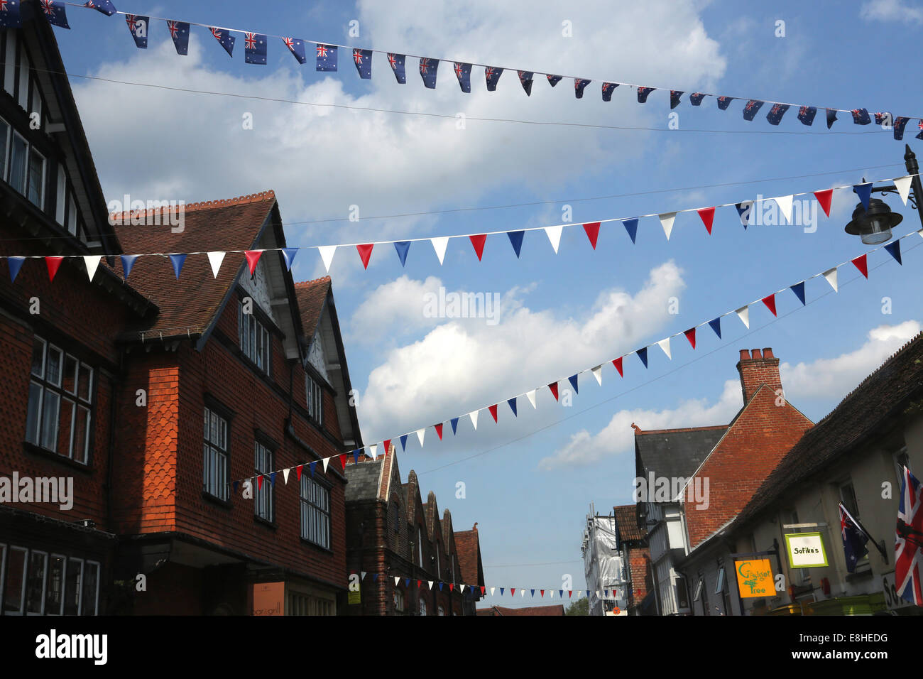 Bunting Above Shops In Lyndhurst High Street New Forest Hampshire England - Stock Image