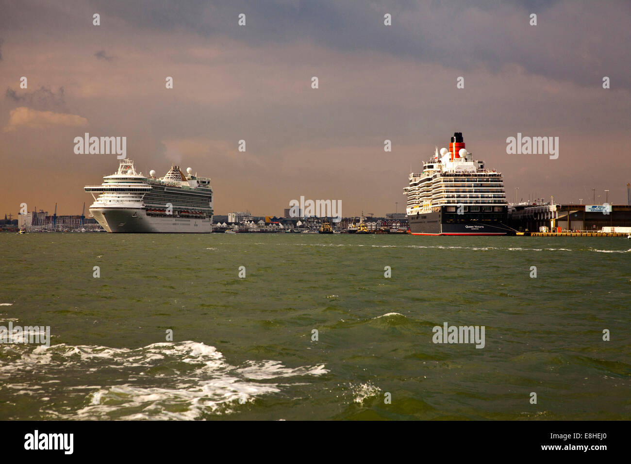 Cruise liners  Queen Elizabeth 2 and  Azura in dock at Southampton - Stock Image