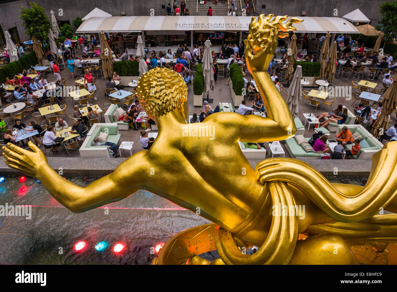 The statue of the Titan God, Prometheus sits above the sunken plaza at the Rockefeller Center located in Midtown - Stock Image