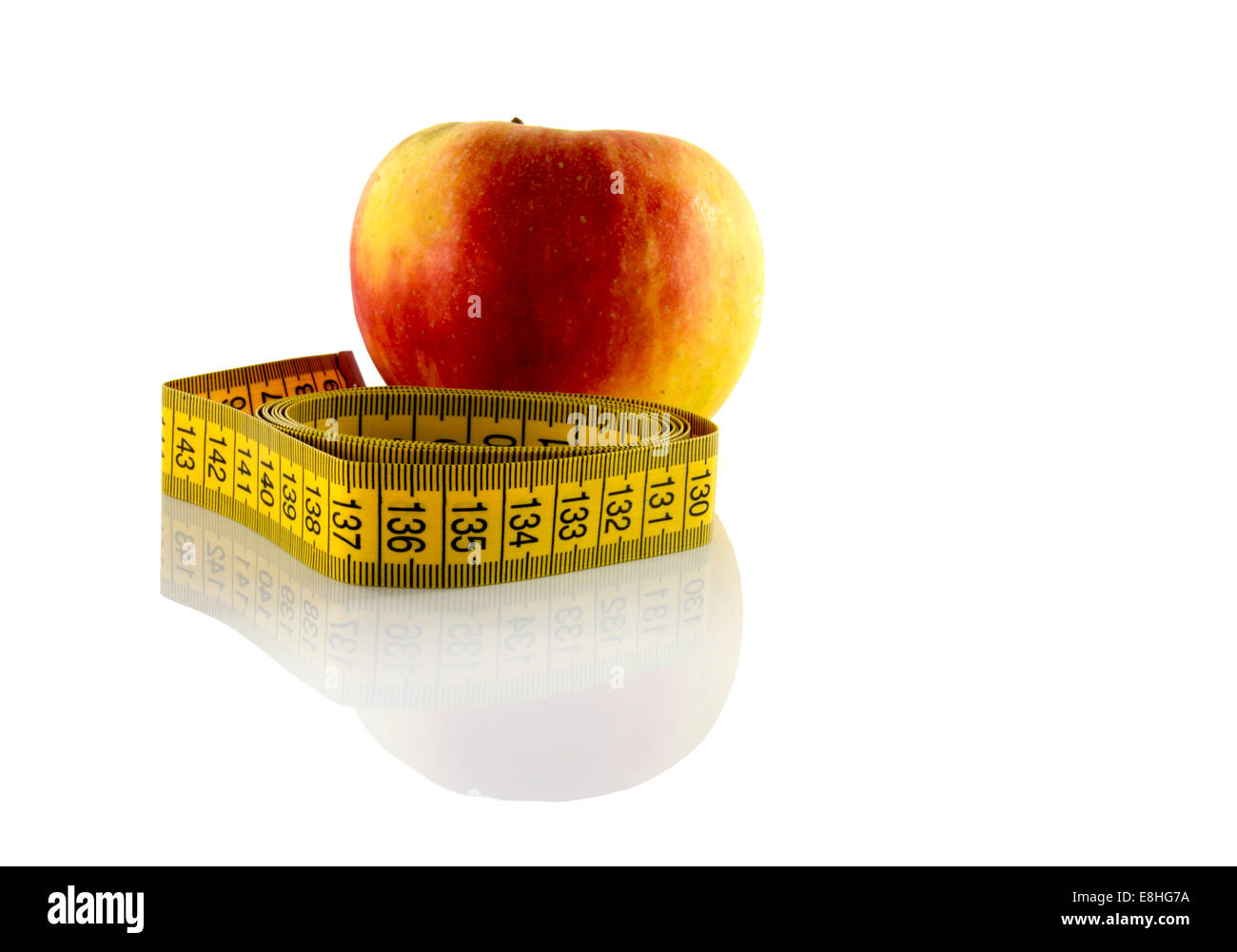 apple measured the meter on a white background - Stock Image