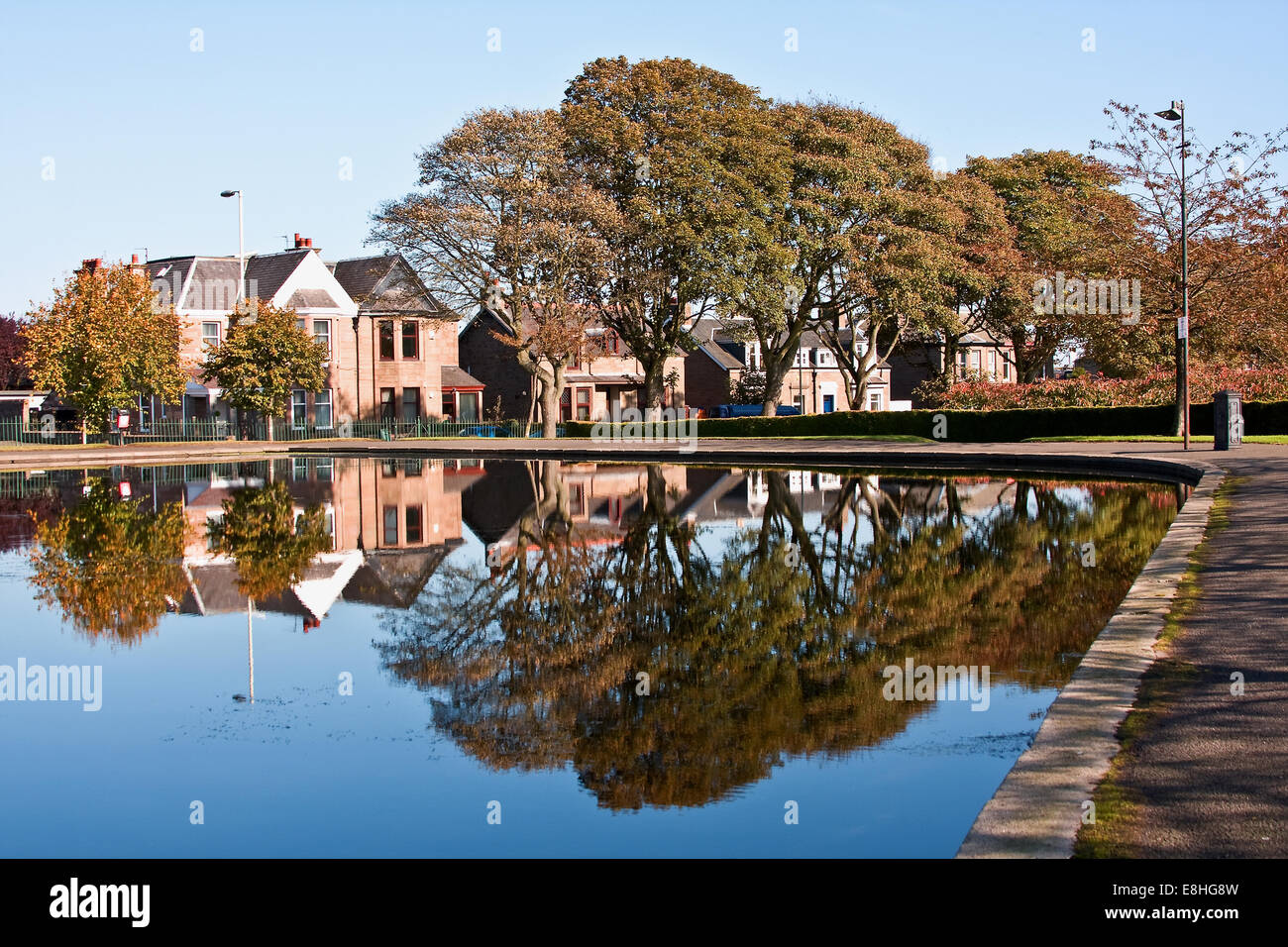 Crisp and clear colourful Autumn reflections on the calm waters of Stobsmuir Ponds in Dundee, UK Stock Photo