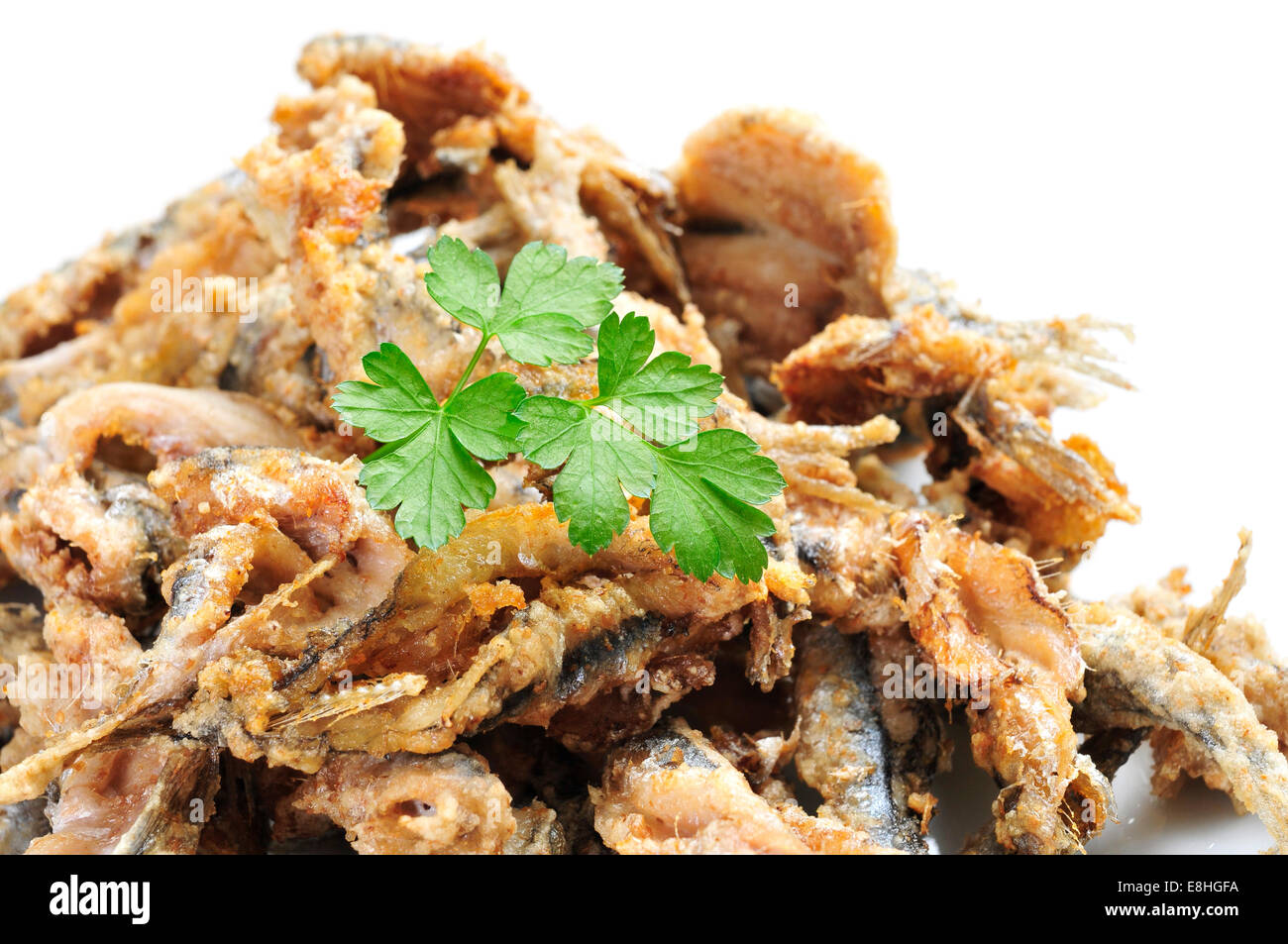 closeup of some spanish boquerones fritos, fried anchovies typical in Spain, served as tapas - Stock Image