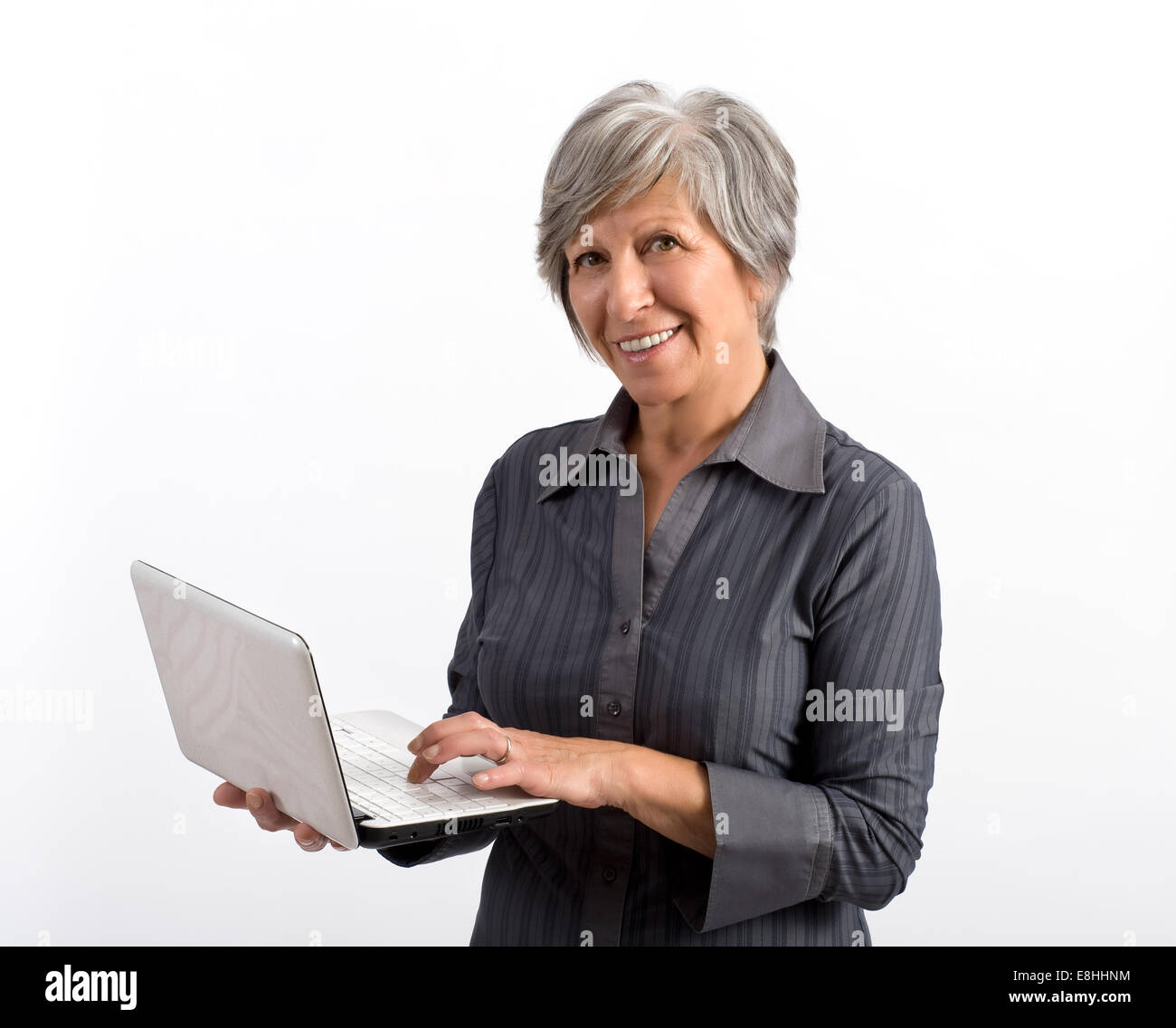 Smiling Woman Holding Laptop - Stock Image