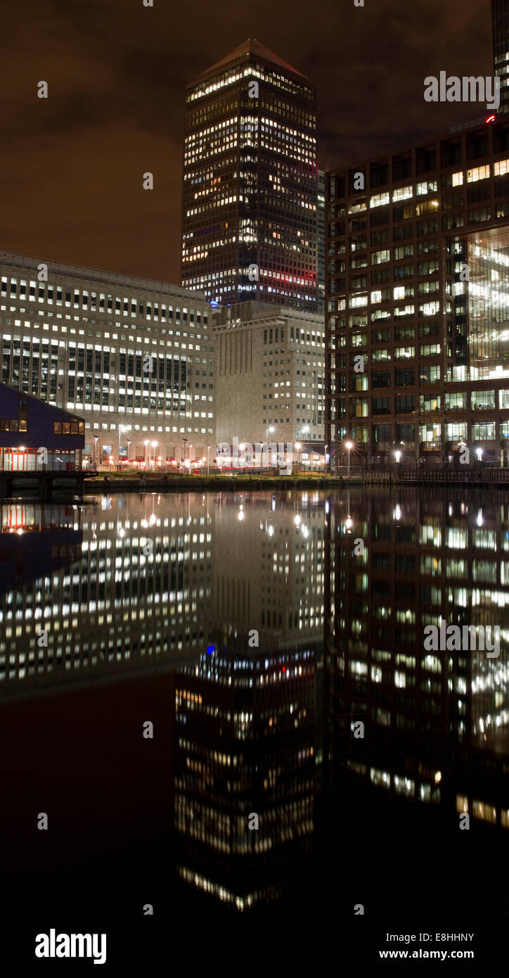 One Canada Square with perfect water reflection in South Dock, Docklands, London, England - Stock Image