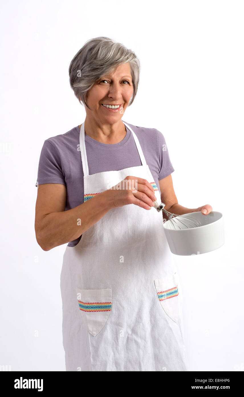 Elderly woman cook - Stock Image