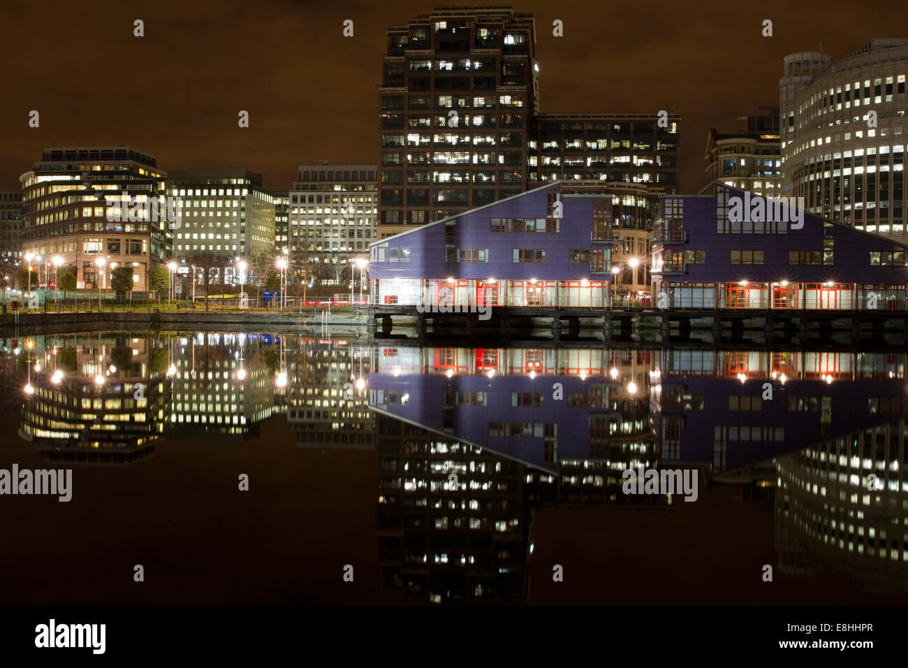 Reflections in water of the various buildings in London's Canary Wharf Financial District. - Stock Image