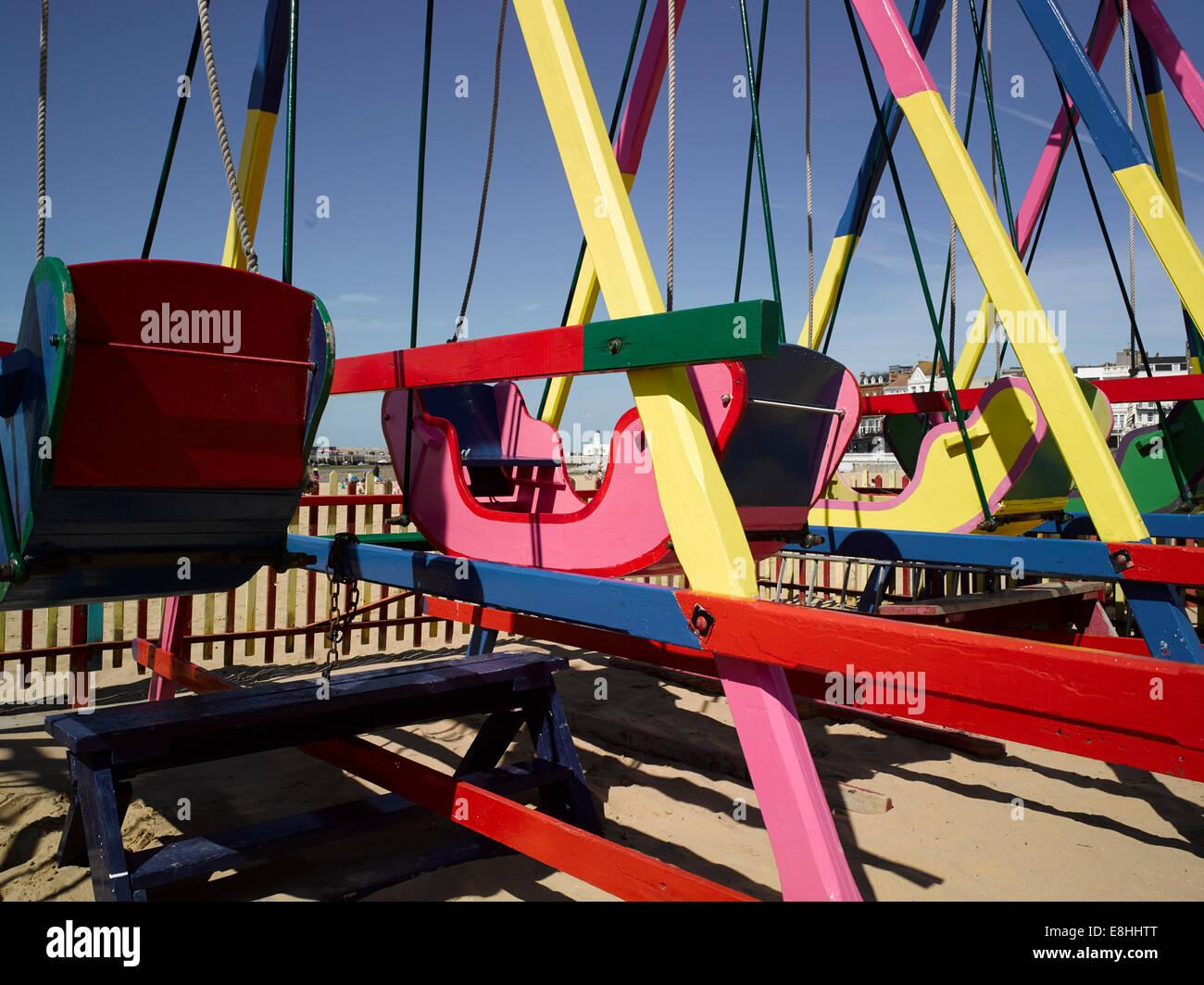 Wooden swings on Margate Beach, Kent, UK - Stock Image