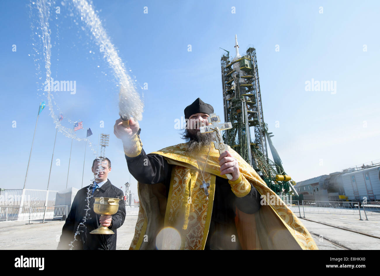 An Orthodox priest blesses members of the media on the Soyouz launch pad at the Baikonur Cosmodrome launch pad on - Stock Image
