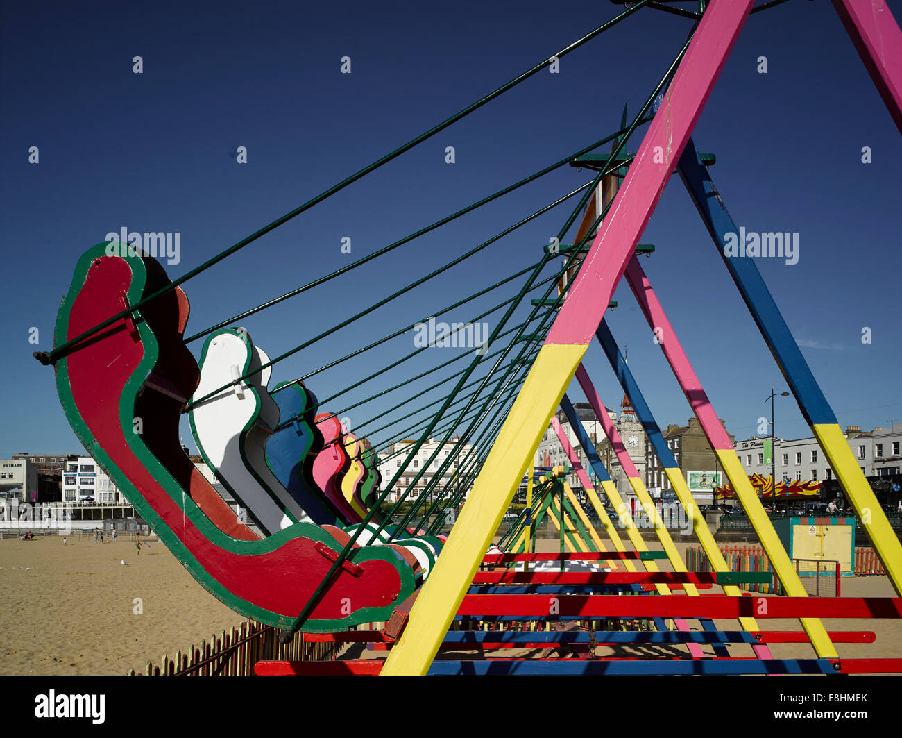 Swings on the beach at Margate, Kent, UK - Stock Image