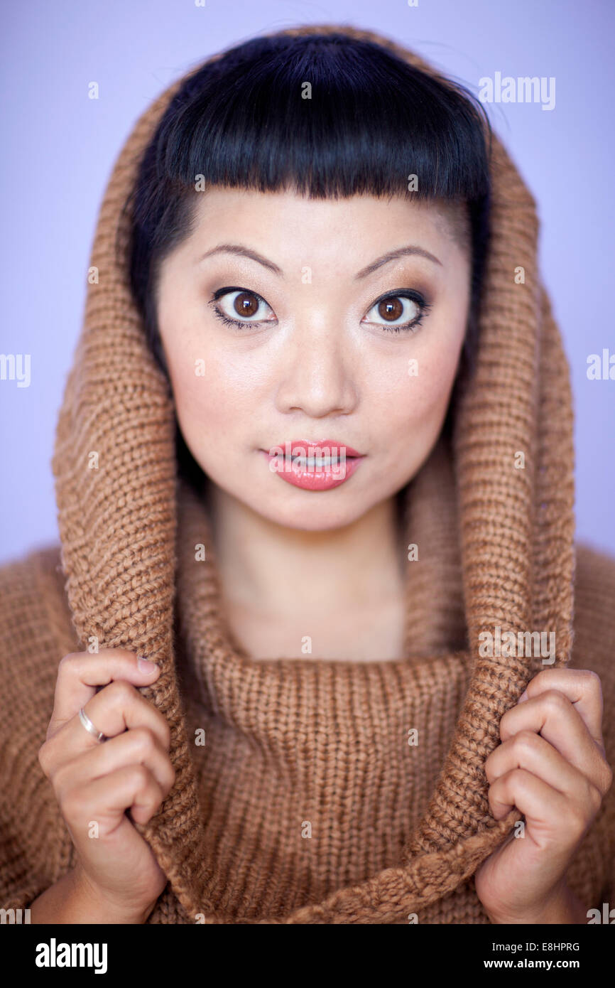 Asian Woman With Warm Fuzzy Cowl Neck Sweater On Short Hair Cut