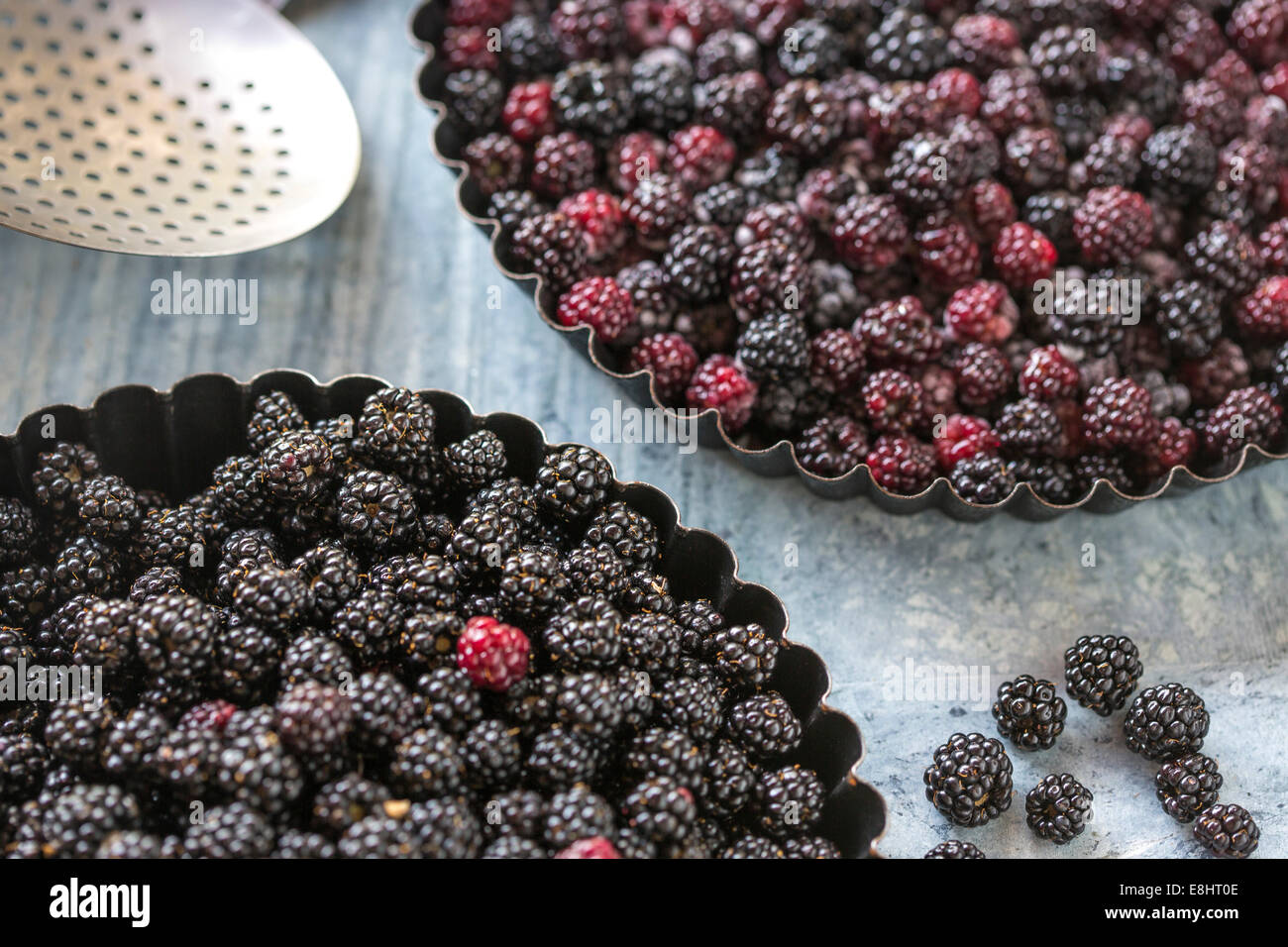 blackberries for home baking a pie or crumble, against green marble, - Stock Image