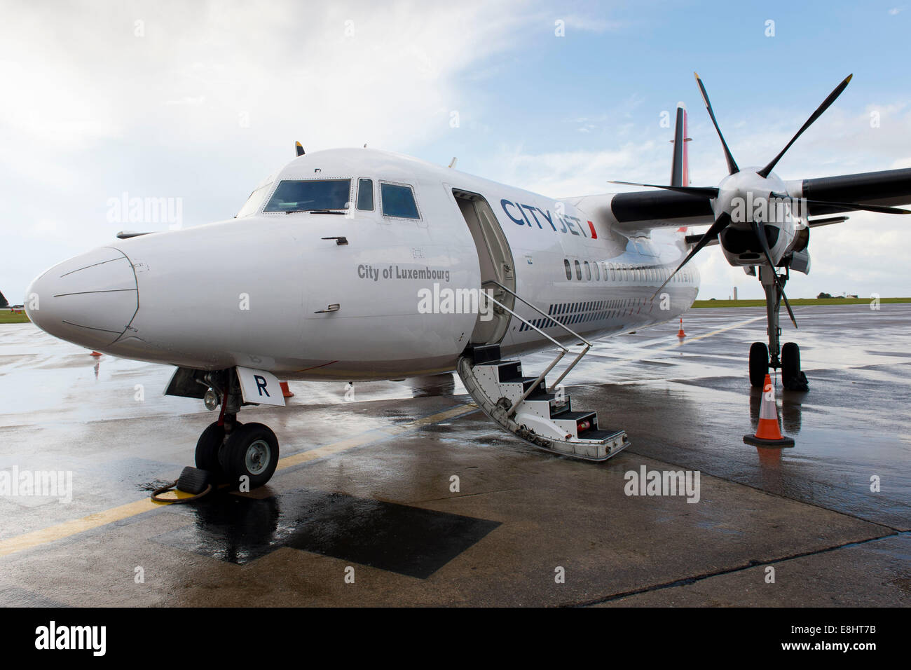 A CityJet Fokker 50 jet airplane preparing for a flight to Luxembourg at Cardiff Airport, South Wales. - Stock Image