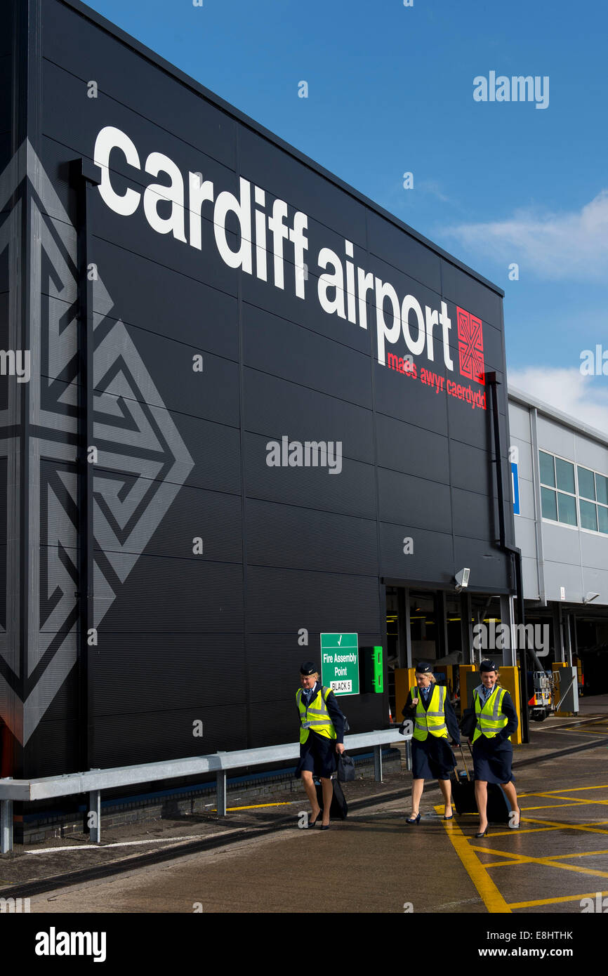 Cabin crew airside at Cardiff Airport. - Stock Image