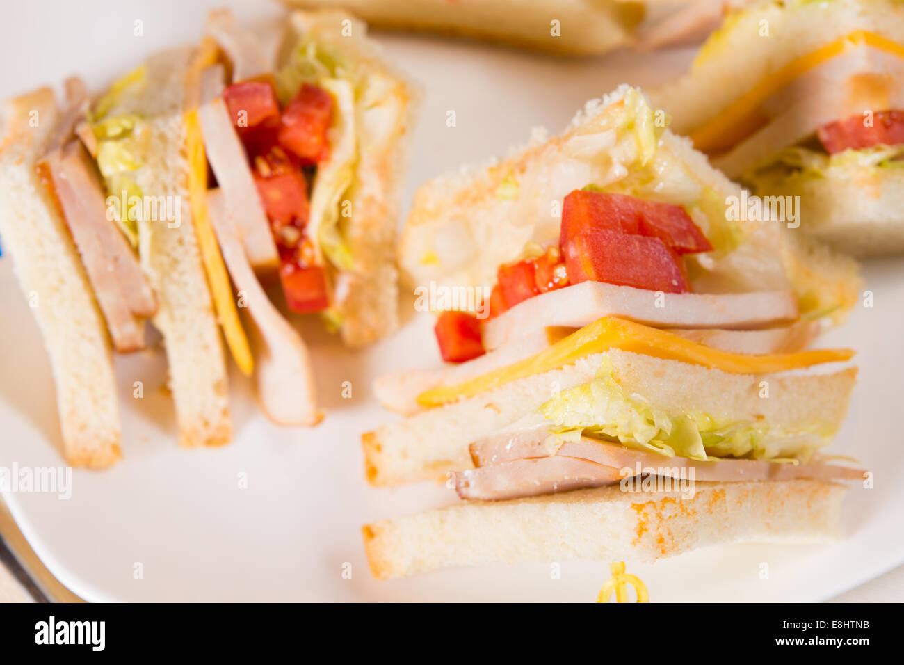 Detail of Triple Decker Sandwich on Plate Stock Photo