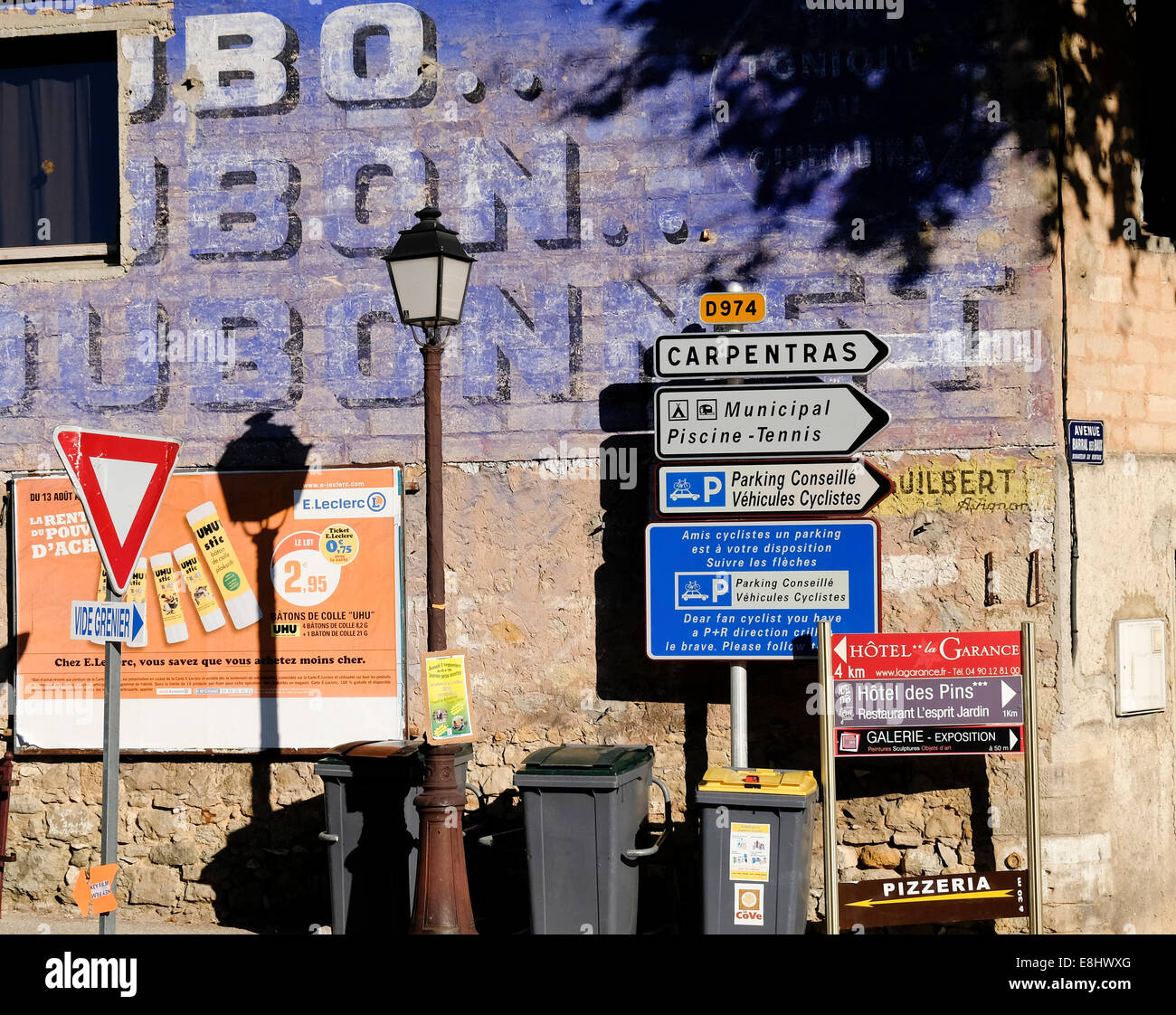 Signs and old faded advert on a wall, Bedoin, Provence, France - Stock Image